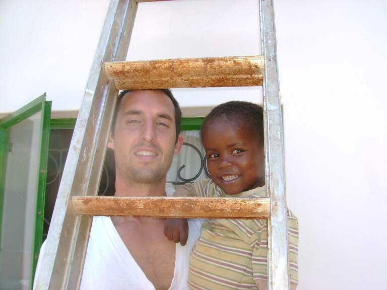 Kirk and Child seen through a ladder