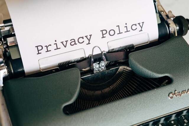 """Picture of old typewriter with paper saying """"Privacy Policy"""""""