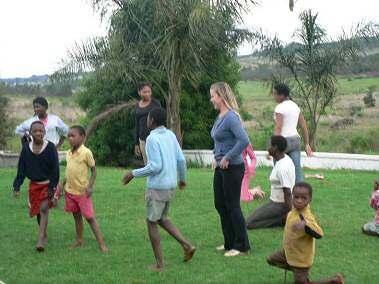 Volunteer playing wiht the children
